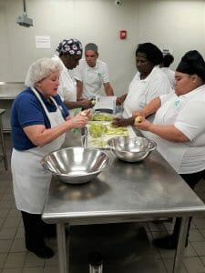 Culinary Training Program students learning to cook in the Pathlight Kitchen free 12-week training