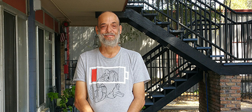 Mark stands in front of his affordable housing for chronically homeless people in Orlando at Maxwell Terrace