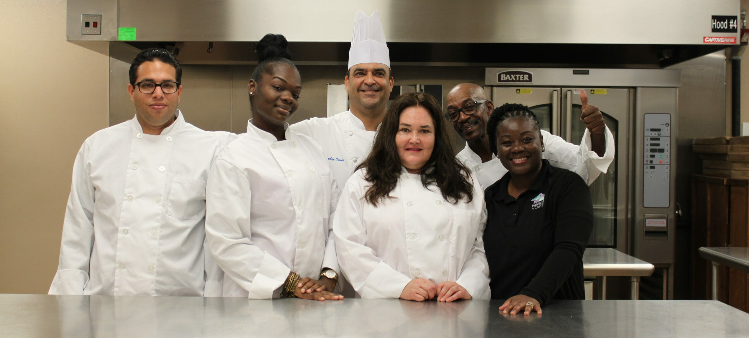 Graduates from the Pathlight Kitchen Culinary Program