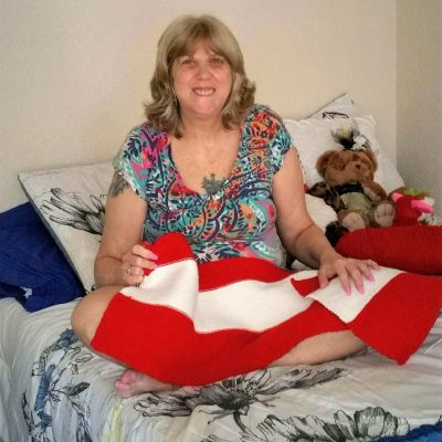 Photo of Jennifer, a resident of Pathlight Home's Safe Haven program, enjoying her apartment