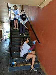 Volunteers painting Maxwell Garden, an affordable efficiency apartments for low-income residents in Orlando