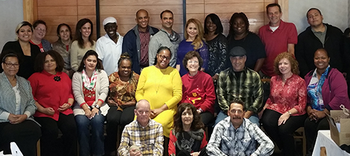 Staff members at Pathlight HOME gather to celebrate winning second place in the Best Places to Work for Nonprofit Multifamily Affordable Housing
