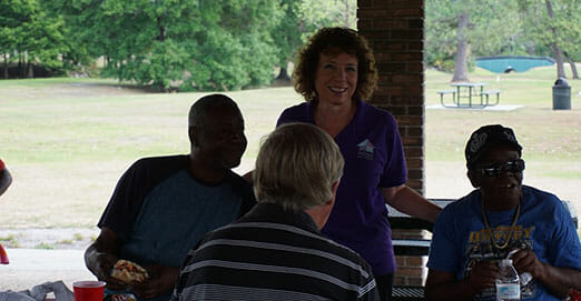 Residents in the Restore permanent supportive housing program participate in a picnic