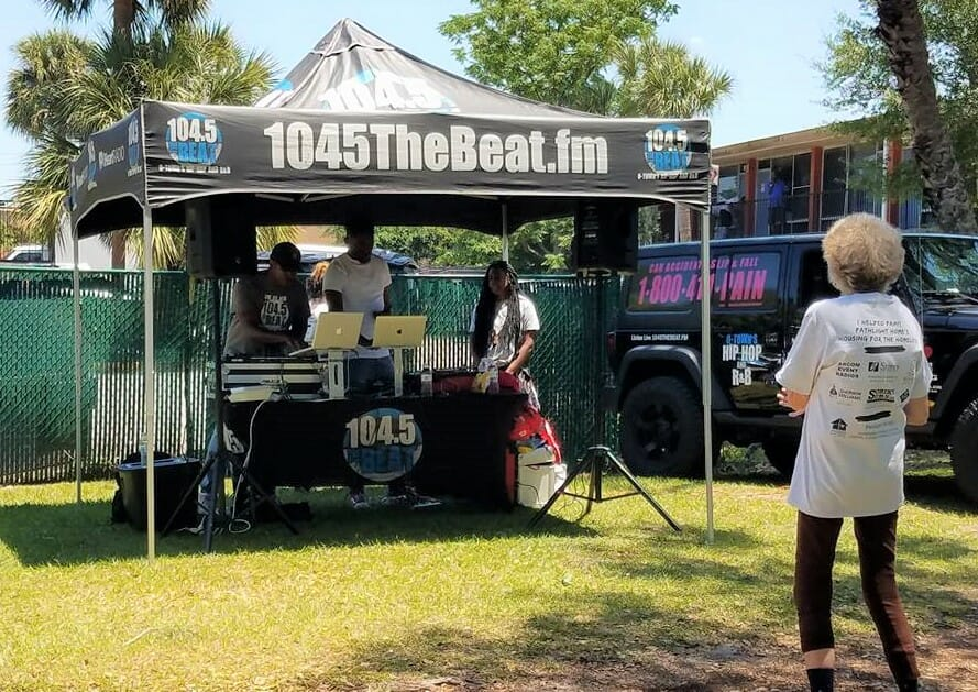 Radio Station 104.5 The Beat volunteers and plays music at Pathlight HOME's painting day at Maxwell Garden