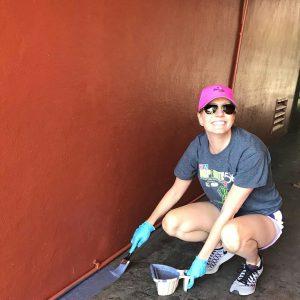 Volunteer painting housing for Orlando chronically homeless residents of Pathlight HOME